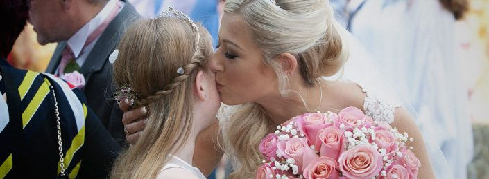 Leicester wedding photography bride kisses daughter, rose bouquet, Leicestershire wedding photography