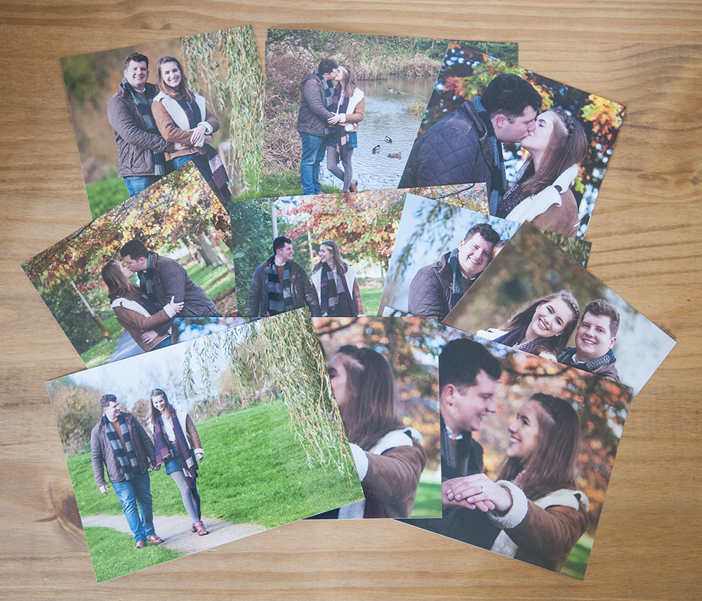 printed photos of an engaged couple