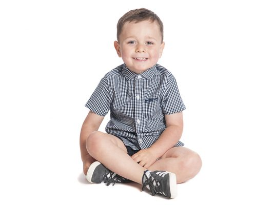 cute boy crossed legs checked shirt smiling professional photo leicester