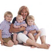 studio photoshoot grandma granny gran nan nanna grandchildren white background hug cuddle baby