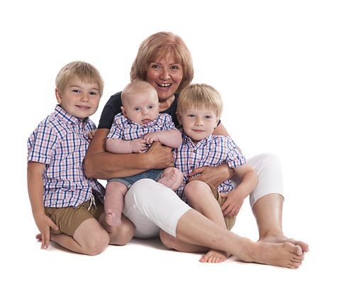 studio photoshoot grandma granny gran nan nanna grandchildren white background hug cuddle baby