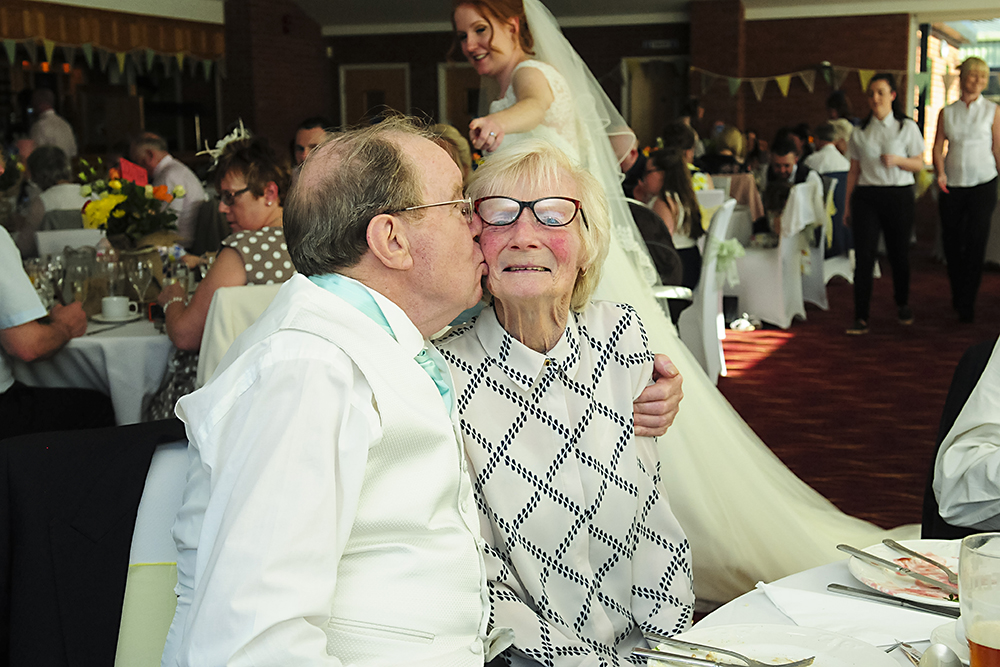 bride spots grandfather kissing grandmother on wedding day, beautiful, touching moment