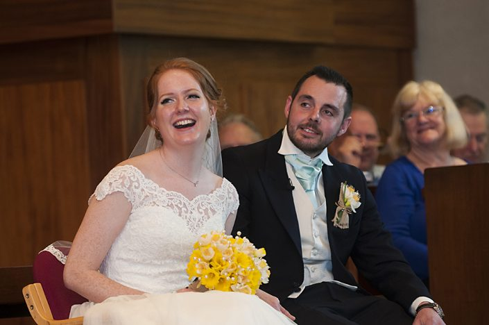 relaxed laughing bride and groom in church wedding ceremony, Birstall, Leicestershire