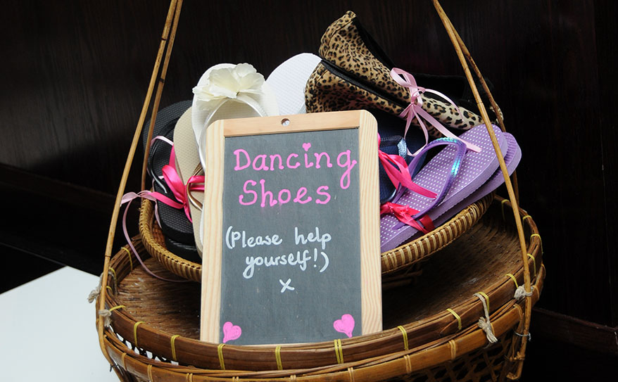 basket of flip flops and flat shoes for wedding guests to wear on the dance floor, thoughtful bride, Leicester wedding