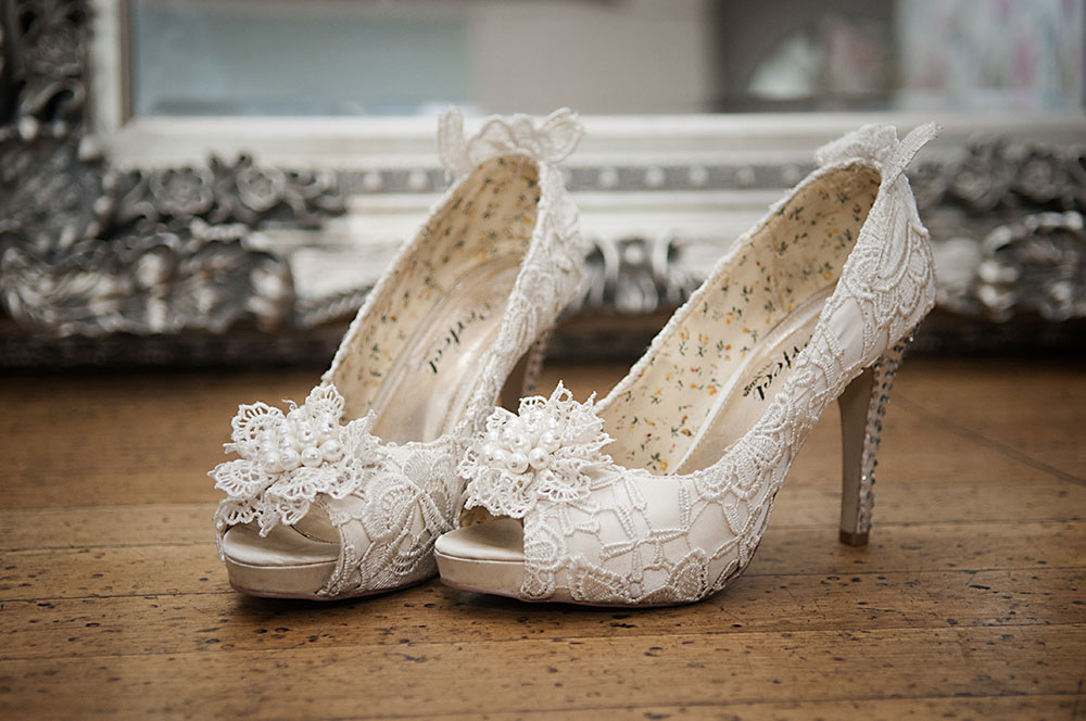 lace bridal shoes in white, high heeled with pretty ankle detail, Leicestershire wedding photograph Rose Tinted Photos