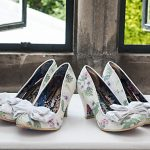 irregular choice bridal shoes and bridesmaid matching shoes with home made paper flower bouquets on windowsill