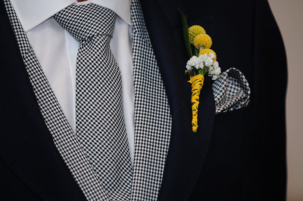 Groom's suit and buttonhole, dogtooth tie lapels handkerchief