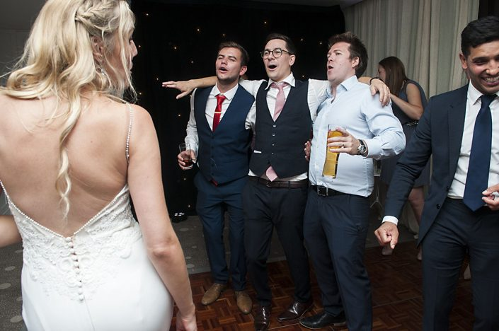 party animal bride and groom dancing with friends at wedding reception leicestershire wedding photographer, leicester wedding photography