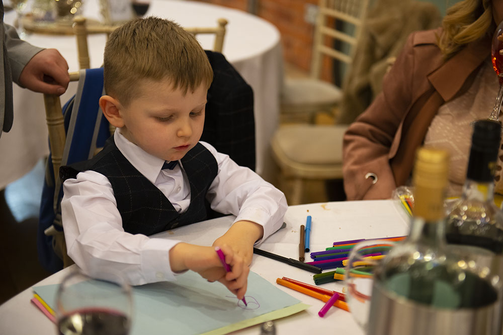 children at weddings entertainment drawing during speeches leicester