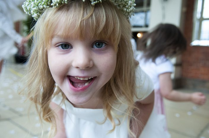 close up of young bridesmaid pulling face, flower girl leicester photographer