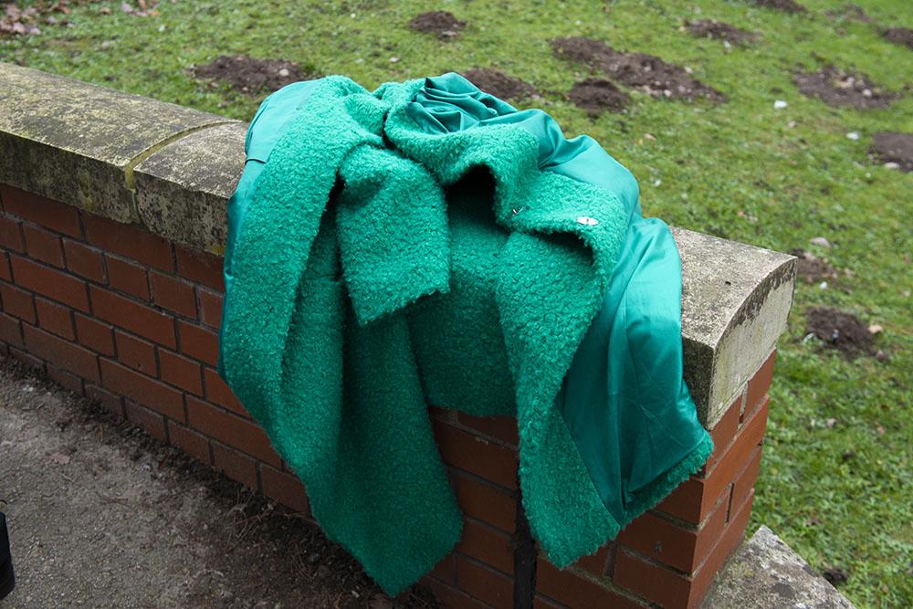 abandoned coat at cold winter wedding