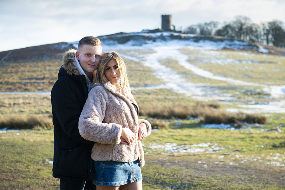 engaged couple at Bradgate Park, Leicestershire snow at Old John, snowy wedding day, rose tinted photos, rachael ince