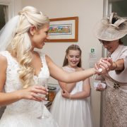 mum admires daughter in wedding dress, bride, mother of the bride, bridesmaid, wedding day emotions, Rose Tinted Photos