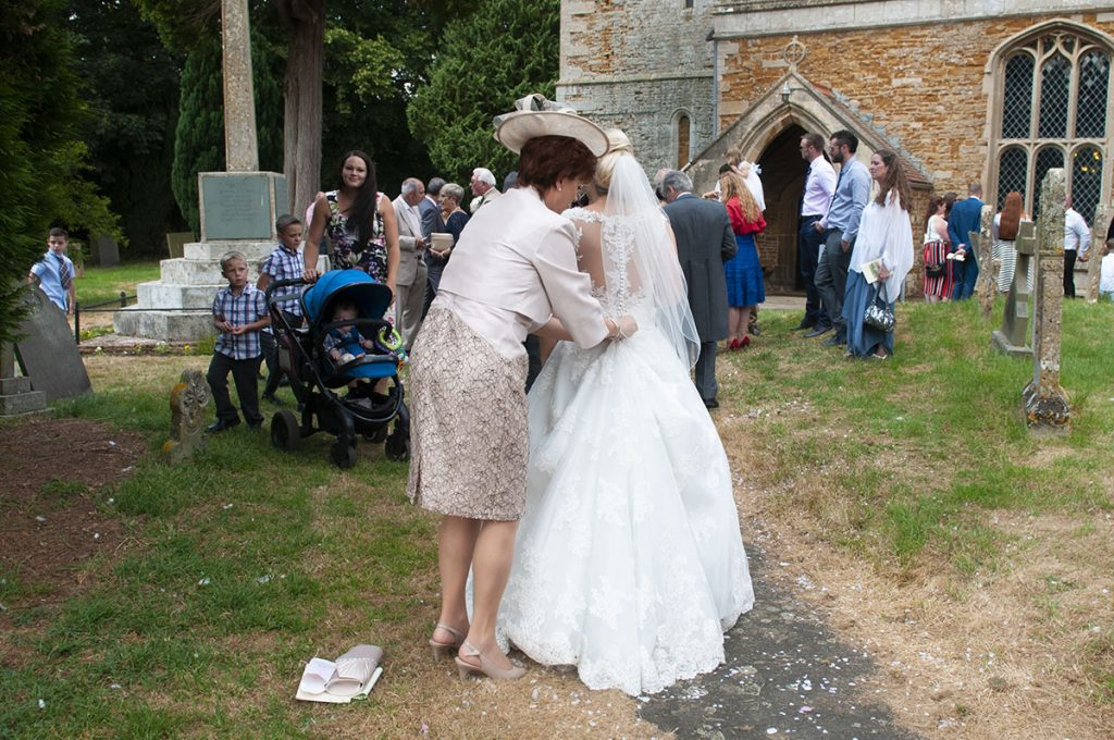 mother of the bride helps daughter with wedding dress, bride in white, dress up, melton wedding photography, Rose Tinted Photos