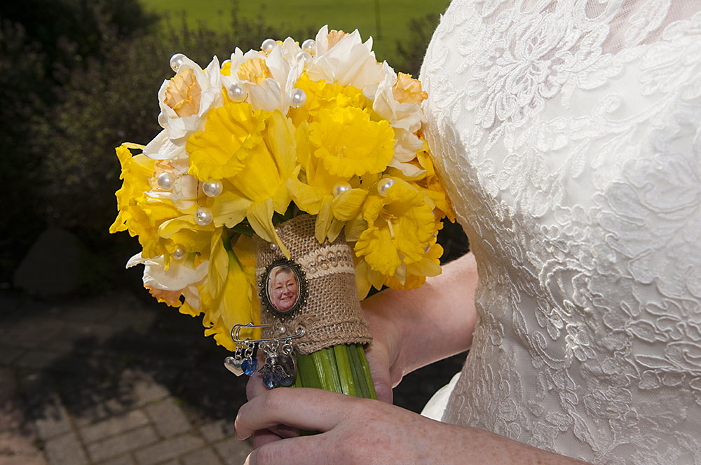 wedding day bridal bouquet of daffodils with photograph of deceased relative loved one, leicester wedding photography