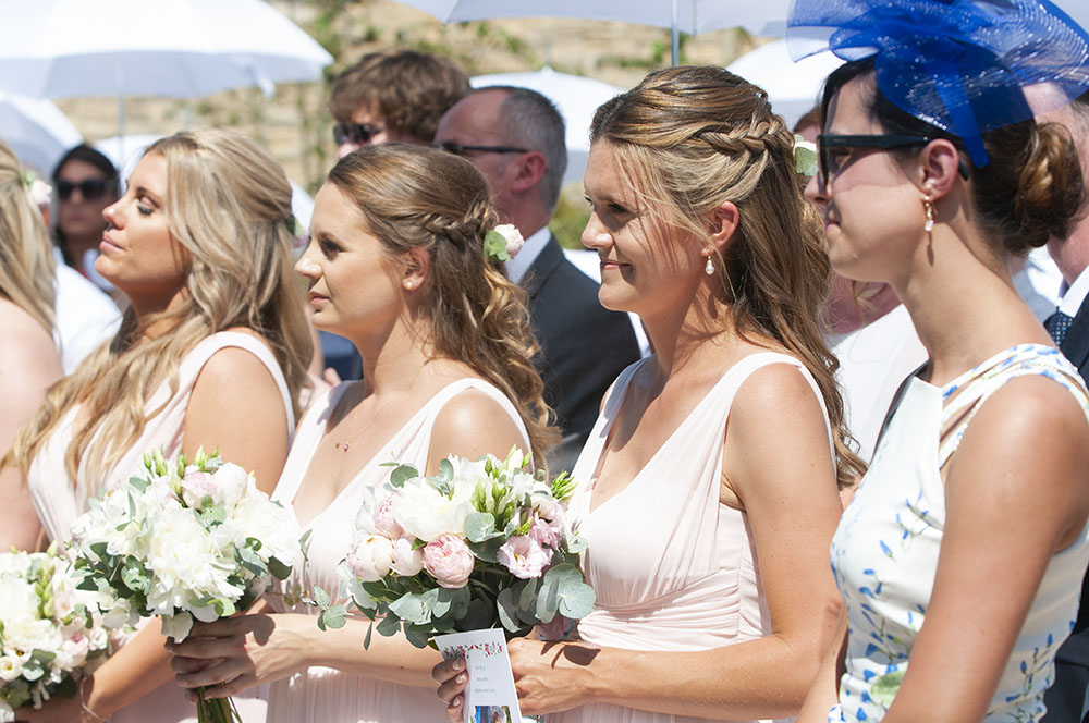 Bridesmaid get emotional at outdoor wedding, bouquet, sunshine, hot day, wedding photographer leicester