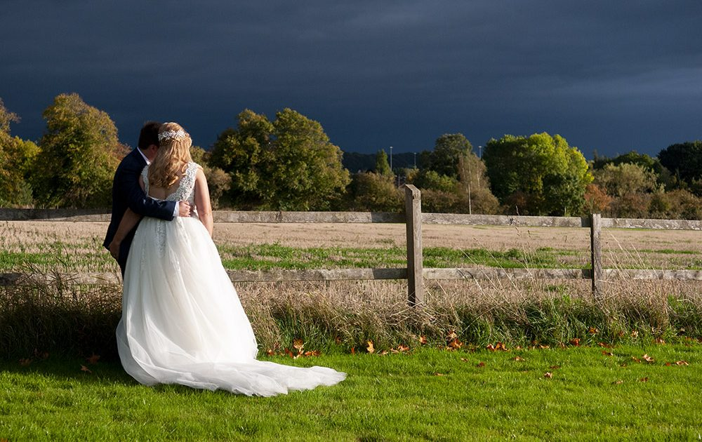 legal requirements to marry in leicestershire, newlyweds bride groom stormy sky wedding photography, leicester wedding photographer