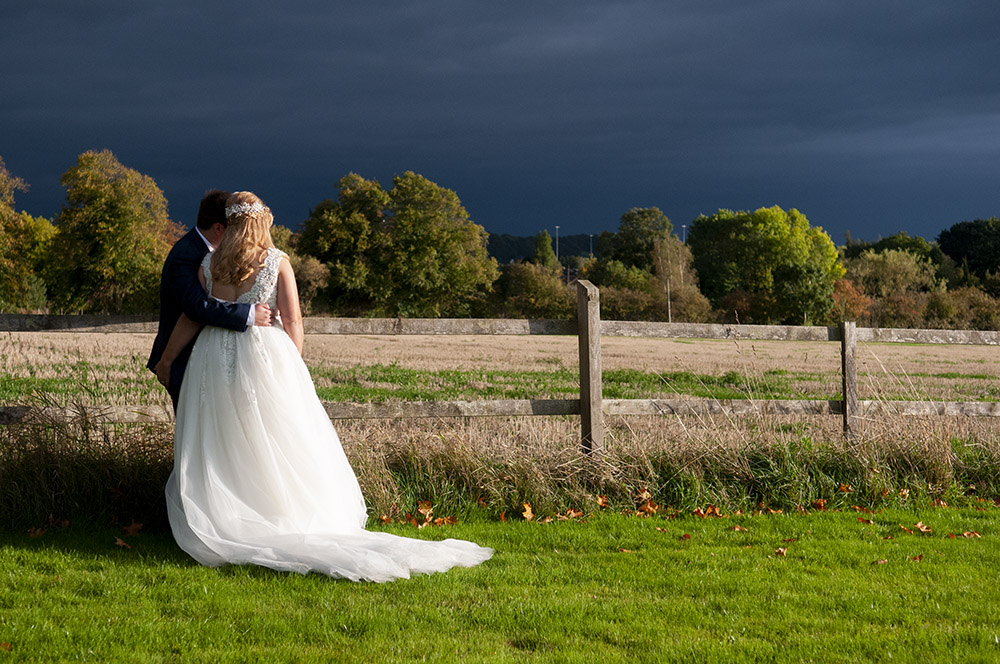 legal requirements to marry in leicestershire, newlyweds bride groom stormy sky wedding photography