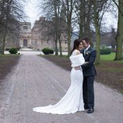 leicestershire wedding photography bride and groom embrace in front of country house ruins, winter wedding leicester wedding photographer