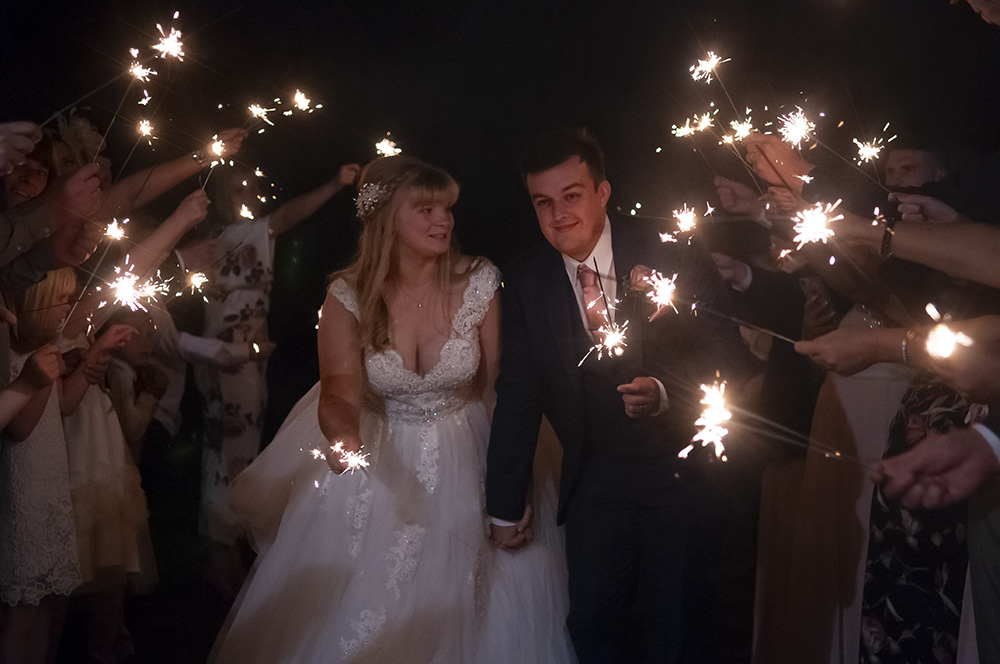 bride and groom with sparklers and guests wedding fireworks display leicestershire wedding photographer