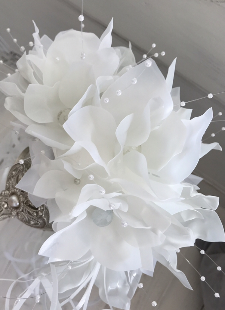 alternative bridal bouquet, white flowers made from old milk bottles